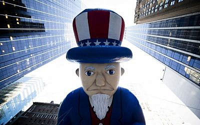 A giant Uncle Sam balloon is marched down 6th Avenue during the 87th Annual Macy's Thanksgiving Day Parade, Thursday, Nov. 28, 2013, in New York (photo credit: AP/John Minchillo)