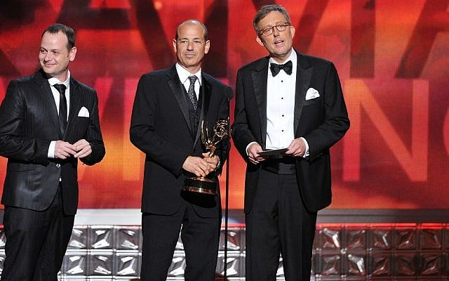 Writers Gideon Raff, left, Howard Gordon, center, and Alex Gansa accept Outstanding Writing for a Drama Series award for 'Homeland' onstage at the Emmy Awards on September 23, 2012 in Los Angeles, California. (Photo credit: AP/Vince Bucci/Invision for the Academy of Television Arts & Sciences/)