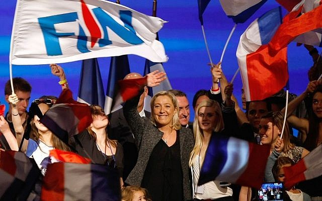 French far-right party leader Marine Le Pen waves to supporters, at the end of the National Front's summer convention in Marseille, southern France, Sunday, Sept. 15, 2013. (photo credit: AP Photo/Claude Paris)