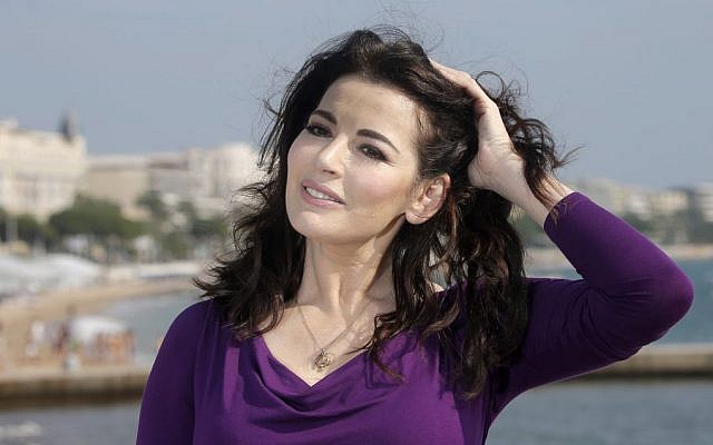English food writer, journalist and broadcaster, Nigella Lawson poses during the 28th MIPCOM (International Film and Programme Market for Tv, Video,Cable and Satellite) in Cannes, southeastern France, Tuesday, Oct. 9, 2012. (photo credit: AP Photo/Lionel Cironneau )