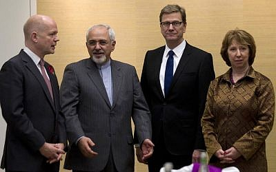 British Foreign Secretary William Hague (left), Iranian FM Mohammad Javad Zarif (second left), Germany's FM Guido Westerwelle, and EU High Representative for Foreign Affairs, Catherine Ashton (right), gather for the third day of closed-door nuclear talks in Geneva, Switzerland, on Saturday, November 9, 2013. (photo credit: AP/Jason Reed/Pool)