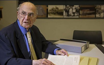 Harold Burson, 92, donates a never-before-published transcript of coverage of the Nuremberg trials to the U.S. Holocaust Memorial Museum in Washington on Tuesday Nov. 19, 2013. (photo credit: AP Photo/Jacquelyn Martin)
