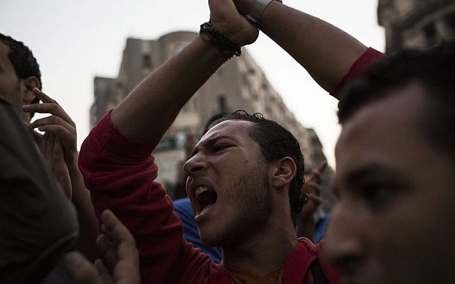 Egyptian youths chant slogans during a demonstration in support of Egyptian political satirist Bassem Youssef after a local TV station stops the airing of his show in Cairo, Egypt, Saturday Nov. 2, 2013 (photo credit: AP/Manu Brabo)