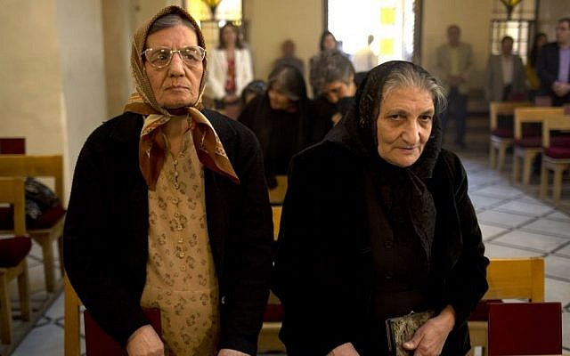 In this photograph taken on Sunday, Oct. 27, 2013, women stand during a service in an Armenian Orthodox church in Damascus, Syria (photo credit: AP/Dusan Vranic)