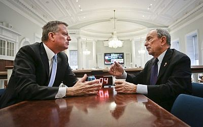 Then- New York City Mayor-elect Bill de Blasio, left, joins Mayor Michael Bloomberg for a meeting in the 'Bull Pen,' the mayor's main City Hall office, on Wednesday, Nov. 6, 2013, in New York. (photo credit: AP Photo/Bebeto Matthews)