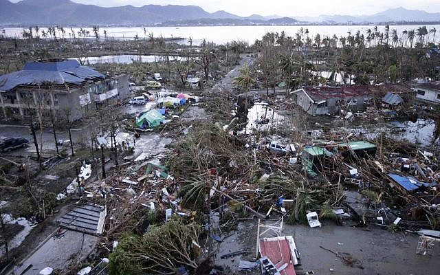 Tacloban Airport is covered by debris after powerful Typhoon Haiyan hit Tacloban city, in Leyte province in central Philippines, Saturday, Nov. 9, 2013 (photo credit: AP/Bullit Marquez)