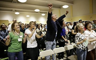 A new mega-church movement is generating buzz from London to Los Angeles, but this time it's a belief in non-belief that's drawing crowds on Sunday mornings. (photo credit: AP Photo/Jae C. Hong)