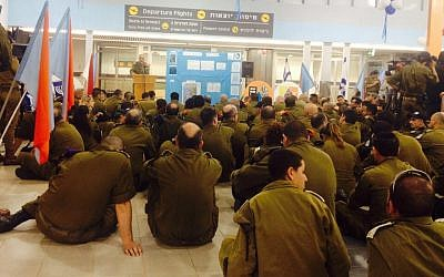 IDF soldiers at Ben Gurion airport before the departure of their flight to Thailand, where they were set to erect o field hospital for victims of a devastating typhoon, Wednesday, November 13, 2013 (photo credit: IDF spokesperson, Twitter)