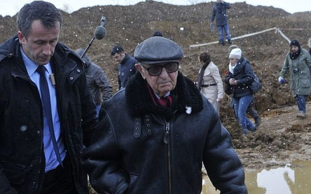 President of the International Criminal Tribunal for the Former Yugoslavia (ICTY) Theodor Meron visits the mass grave Tomasica, near the Bosnian town of Prijedor, 260 km north west of Sarajevo, on Monday, Nov. 25, 2013. (photo credit: AP Photo/Radivoje Pavicic)