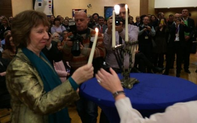 Cathrine Ashton lighting Hanukkah candles at an annual event in Brussels, Belgium, Wednesday, November 27, 2013 (photo credit: official)