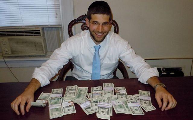 Rabbi Noach Muroff at the desk in which he found $98,000 in cash. (photo credit: Esther Muroff)