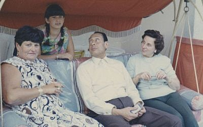 On their 1969 visit to Berlin, a teenage Carla Greenspan is shown with her mother, Anna Gutman, and their hosts, Mohamed and Emmi Helmy (Courtesy Carla Greenspan/JTA)