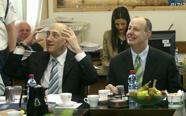Tzachi Hanegbi (right) with then-prime minister Ehud Olmert, in 2007 (Photo credit: Olivier Fitoussi / Flash90)