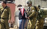 Illustrative photo of Israeli soldiers blindfolding and detaining Palestinians. (Najeh Hashlamoun/Flash90)