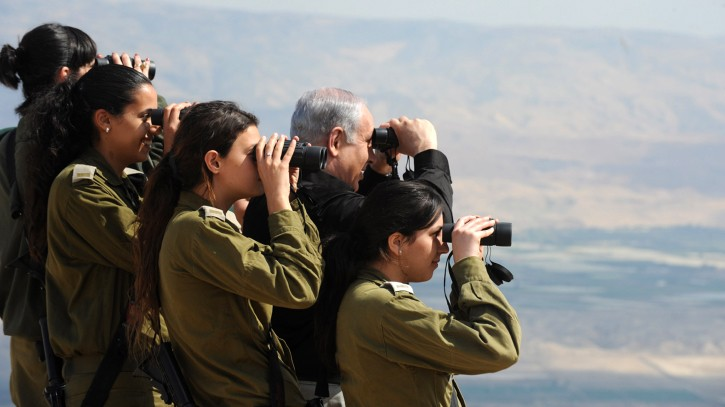 Prime Minister Benjamin Netanyahu observes the Jordan Valley with IDF officers during a tour in 2011 (photo credit: Moshe Milner/GPO/Flash90)