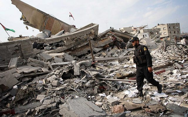A Palestinian police officer walking amid the destroyed buildings in Gaza on the day after the end of Operation Pillar of Defense. (photo credit: Abed Rahim Khatib/Flash90)