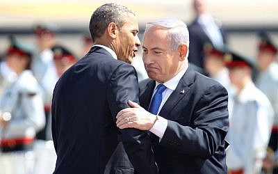 Prime Minister Benjamin Netanyahu and President Barack Obama embrace at a ceremony held in honor of Obama as he lands at Ben Gurion Airport near Tel Aviv, on March 20, 2013. (photo credit: Miriam Alster/Flash90)