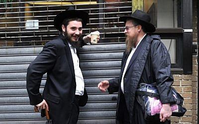 Illustrative photo of Hasidic Jews in Crown Heights, Brooklyn, New York (photo credit: Serge Attal/Flash90)