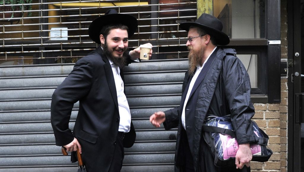Illustrative photo of Hasidic Jews in Crown Heights, Brooklyn, New York (photo credit: Serge Attal/Flash90)