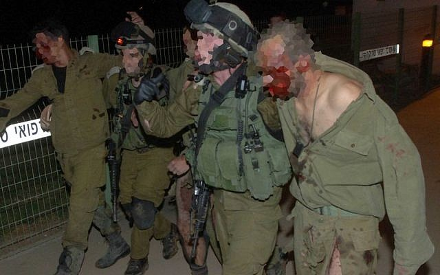 Injured Israeli soldiers are taken into Soroka hospital in Beersheba on October 31, 2013. The IDF said five soldiers when an explosive device went off as troops were clearing a tunnel dug by Hamas from the Gaza Strip into Israel (Photo credit: Dudu Greenspan/Flash90)