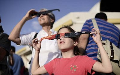 People wear special glasses as they watch a partial solar eclipse at the Givatayim Observatory, Sunday, November 3, 2013 (photo credit: Tomer Neuberg/Flash90)