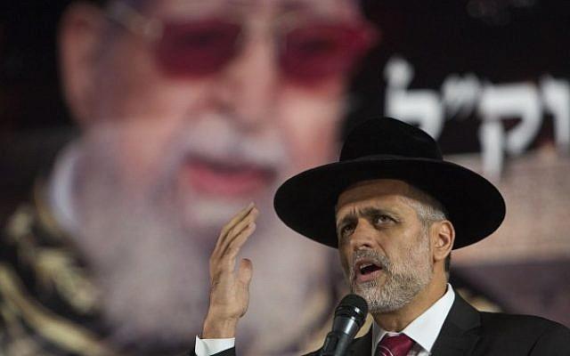 Eli Yishai speaks during a ceremony marking 30 days since the passing of the late religious spiritual leader of Israel's Sephardi Jewry, Rabbi Ovadia Yosef, in Jerusalem on November 5, 2013. (Photo credit: Yonatan Sindel/Flash90)