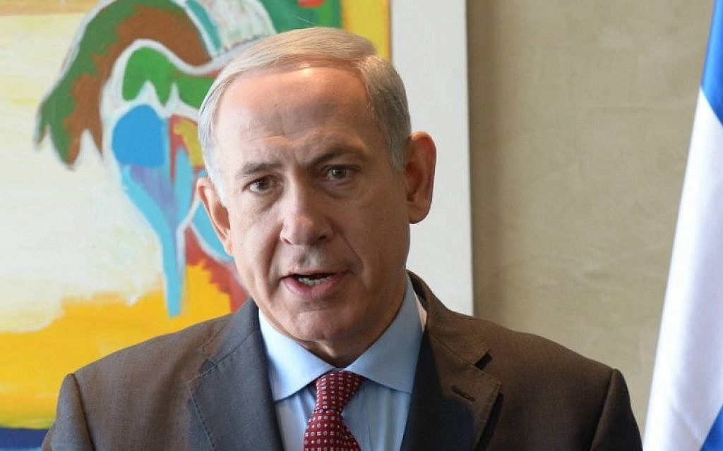 Prime Minister Benjamin Netanyahu makes a statement to the press about Iran at Ben Gurion Airport, Friday, November 8, 2013 (Photo credit: Amos Ben Gershom /GPO/Flash90)