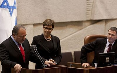 Avigdor Liberman takes his oath of office in front at the Knesset on November 11, 2013. The 120-member House confirmed by a vote of 62 to 17 his reappointment as foreign minister (Photo credit: Flash90)