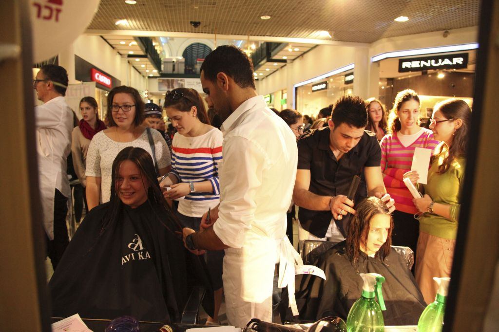 Young Israeli women arrive to donate their hair at a fundraiser arranged by Zichron Menachem. (photo by Meital Cohen / FLASH90)