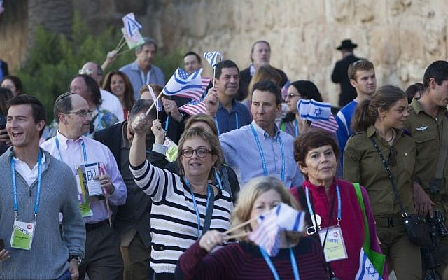 Members of the US Jewish Federations march near the Old City walls during the General Assembly final ceremony, November 12, 2013. (Photo credit: Yonatan Sindel/Flash90)
