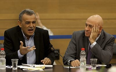 Arab-Israeli MKs Jamal Zahalka (L) and Basel Ghattas (R) seen at an Internal Affairs and Enviornment committee meeting in the Knesset, during a discussion regarding a bill regulating the Bedouin settlements. November 13, 2013. (photo credit: Flash 90)