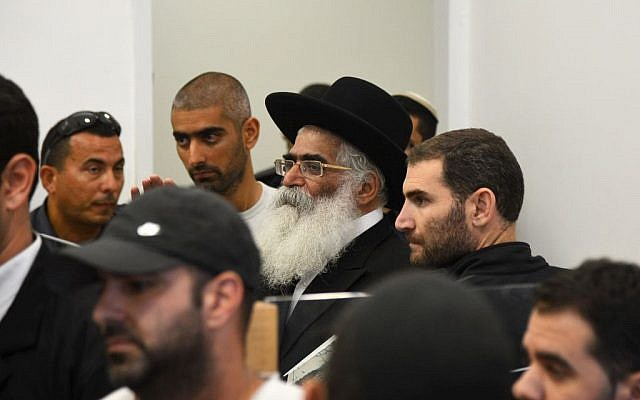 Rabbi Yoram Abergel, center, seen at the Lod District Court during a court hearing on November 14, 2013. (photo credit: Flash90)