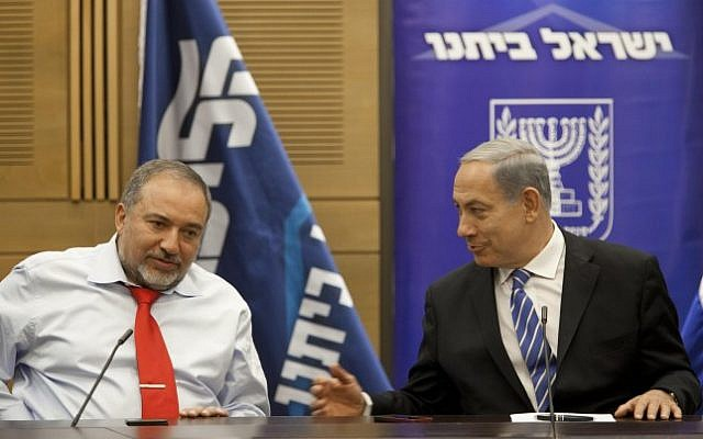 Prime Minister Benjamin Netanyahu and Foreign Minister Avigdor Liberman seen during a meeting of the Likud-Yisrael Beytenu faction in the Knesset on November 18, 2013. (Photo credit: Flash90)