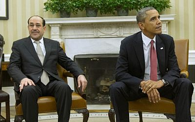 President Barack Obama, right, and Iraqi Prime Minister Nouri al-Maliki stay in their seats, Friday, Nov. 1, 2013, following a meeting in the Oval Office of the White House in Washington (photo credit: AP/Pablo Martinez Monsivais)