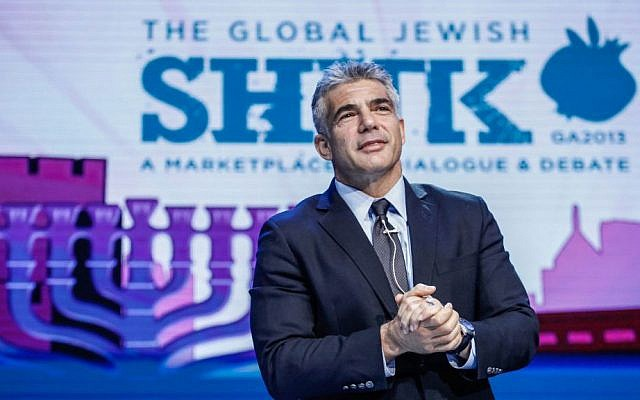 Finance Minister and Yesh Atid party leader Yair Lapid addresses the General Assembly in Jerusalem, November 2013. (photo credit: Flash90)