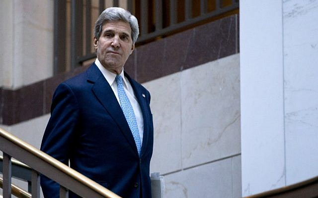 US Secretary of State John Kerry walks to a meeting with the Senate Banking Committee in Washington, DC, on Wednesday (photo credit: AP/Carolyn Kaster)