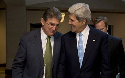 US Secretary of State John Kerry walks with Senate Banking Committee member Democratic Sen. Joe Manchin to a meeting with the committee in Washington, DC, on November 14, 2013. (Carolyn Kaster/AP)