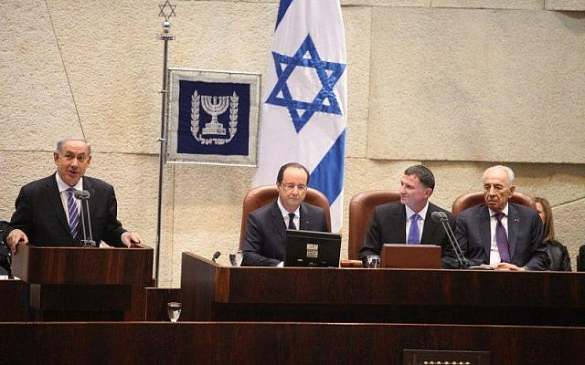 Benjamin Netanyahu speaking in the Knesset Monday, next to Francois Hollande, Yuli Edelstein and Shimon Peres. (photo credit: Knesset Spokesperson)