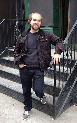 Casimir Nozkowski stands at the steps to his childhood home, a synagogue at 70 Hester Street in New York's Lower East Side. (photo credit: Renee Ghert-Zand)