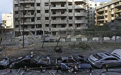 Damaged cars seen in front of a building where many Iranian diplomats live, at the scene of two explosions that struck the day before, near the Iranian embassy, in Beirut, Lebanon, Wednesday, Nov. 20, 2013  (photo credit: AP/Hussein Malla)