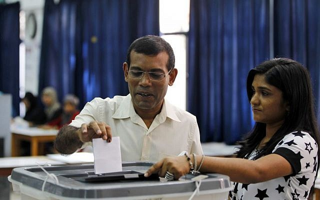 Former President Mohamed Nasheed casts his vote in Male, Maldives on Saturday, November 16, 2013. (photo credit: AP/Sinan Hussain)