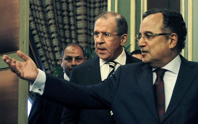 Egyptian Foreign Minister Nabil Fahmy (right), accompanies his Russian counterpart Sergei Lavrov after their meeting in Cairo, Egypt, on November 14, 2013. (photo credit: AP/Amr Nabil)