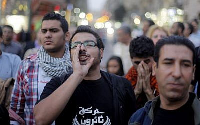 An Egyptian protester chants slogans in Talaat Harb Square in Cairo, Egypt, against the issuance of a new law regulating demonstrations on Thursday, November 28, 2013. (AP Photo/Amr Nabil)