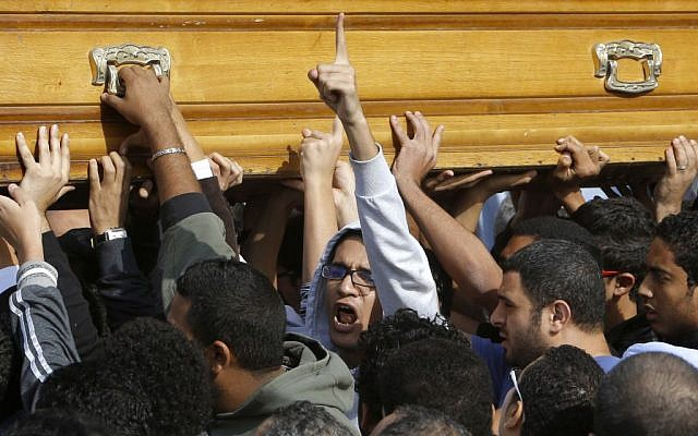 Relatives and colleagues of Mohammed Reda, 19, an Egyptian student who was killed Thursday during clashes with security forces near Cairo University, chant slogans as they carry a coffin following Friday prayers in Cairo, Egypt, Friday, Nov. 29, 2013. (photo credit: AP/Amr Nabil)