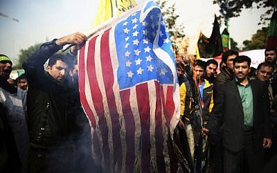 Iranian protesters burn an American flag during an anti-American rally in Tehran, Iran, Monday, Nov. 4, 2013 (photo credit: AP/Ebrahim Noroozi)