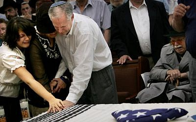 The coffin of Daniel Wultz, covered by a Jewish prayer shawl and a folded American flag, during a memorial service at a Jerusalem synagogue before transferring his body to the US for burial, on May 15, 2006. (photo credit: AP Photo/Oded Balilty)