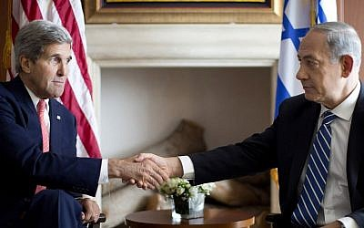 US Secretary of State John Kerry, left, shakes hands with Prime Minister Benjamin Netanyahu in Jerusalem, Wednesday, November 6, 2013 (photo credit: AP/Jason Reed, Pool)