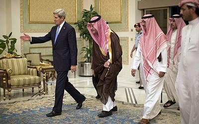 US Secretary of State John Kerry, left, is greeted by Saudi Foreign Minister Prince Saud Al-Faisal bin Abdulaziz al-Saud, after Kerry arrived in Riyadh, Saudi Arabia, FILE-In this Sunday, Nov. 3, 2013 (photo credit: AP/Jason Reed)