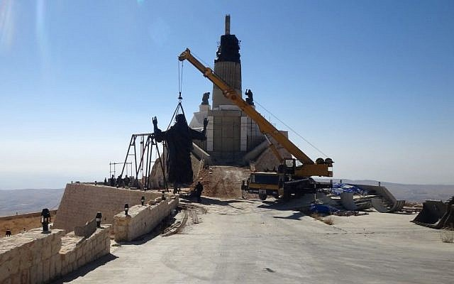 This Oct. 14, 2013 photo provided by the St. Paul's and St. George's Foundation shows workers preparing to install a statue of Jesus on Mount Sednaya, Syria. (Photo credit: AP/Samir El-Gadban, St. Paul's and St. George's Foundation)
