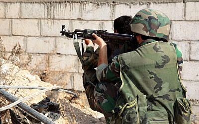 An illustrative of Syrian army soldiers taking a position in November 2013. (photo credit: AP/SANA)